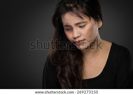 portrait of a asian woman victim of domestic abuse - stock photo