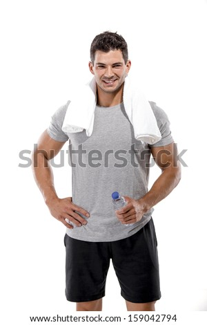 Portrait of a athletic man after doing exercises and holding a bottle of water, isolated over a white background - stock photo