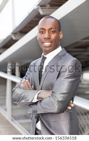 Portrait of a attractive african businessman with arms crossed - stock photo