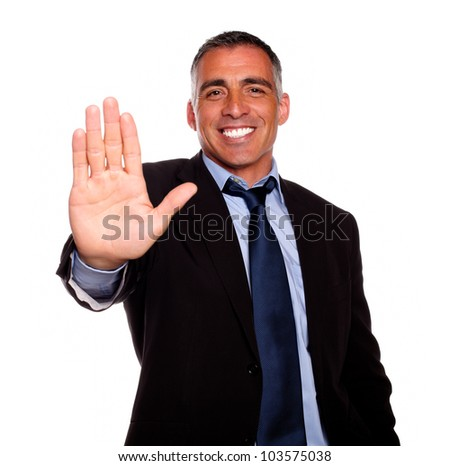 Portrait of a attractive and charming man giving the high on black and blue suit against white background - stock photo