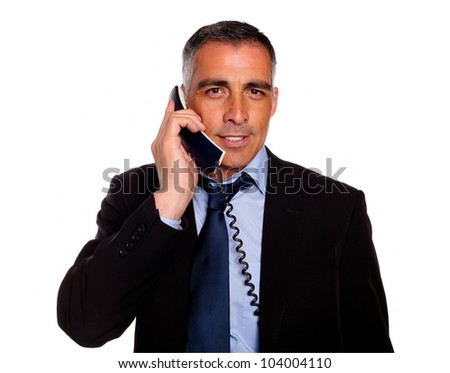 Portrait of a attractive and gorgeous businessman with a phone on black and blue suit against white background - stock photo