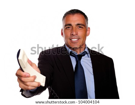 Portrait of a attractive and gorgeous man offering you make a call on black suit against white background - stock photo
