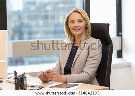 Portrait of a attractive business woman at office