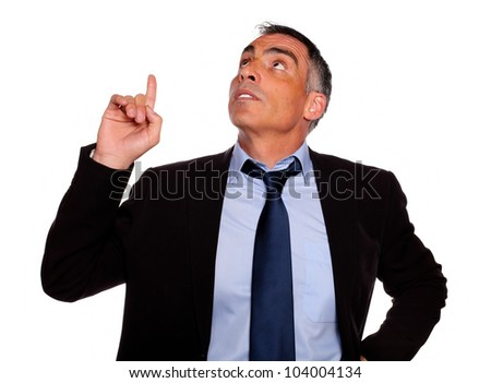 Portrait of a attractive executive looking and pointing up on isolated background - stock photo