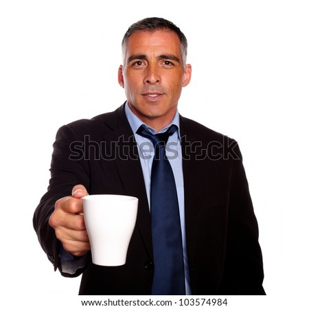 Portrait of a attractive executive with a white mug asking you for fill it against white background - stock photo