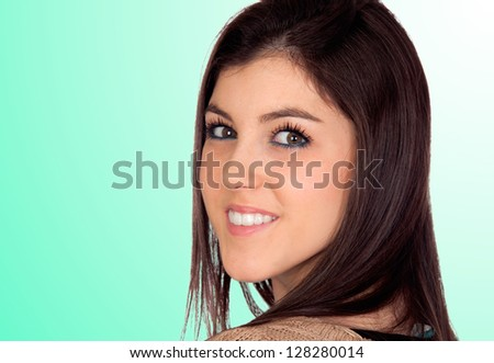 Portrait of a attractive girl isolated on green background - stock photo