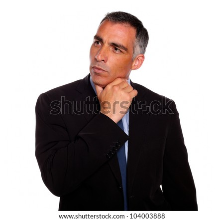 Portrait of a attractive hispanic broker meditative while thinking on black suit on isolated background - stock photo