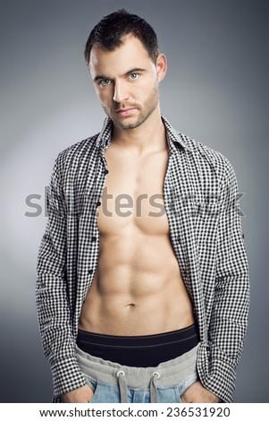 Portrait of a attractive macho man  - stock photo