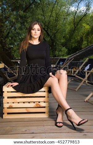 Portrait of a attractive sensuality and beautiful young adult brunette woman in the park