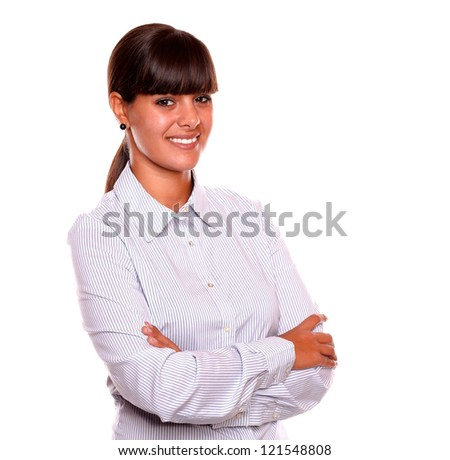 Portrait of a attractive young business female smiling and looking at you standing over white background - stock photo