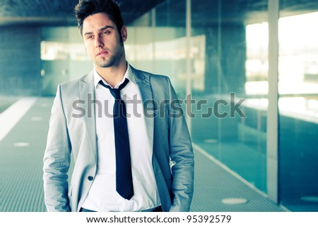 Portrait of a attractive young businessman in office building