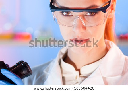 Portrait of a attractive, young, confident female health care professional in hes working environment. - stock photo