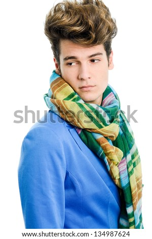 Portrait of a attractive young man wearing blue jacket and scarf with modern haircut - stock photo