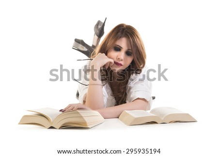 Portrait Of A Attractive Young Woman Reading Book Lying On Floor - stock photo