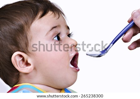 Portrait of a baby eating - stock photo