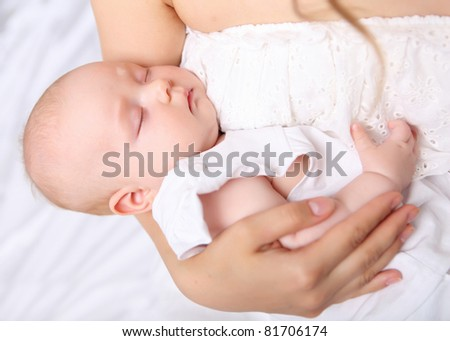 Portrait of a baby girl sleeping on a light background - stock photo
