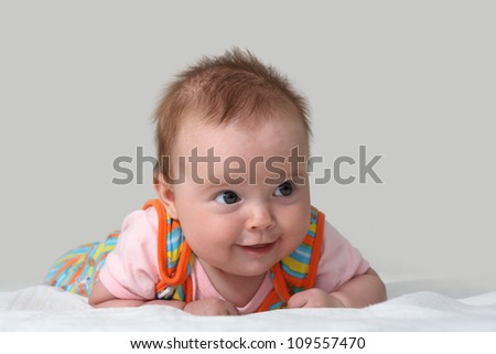 Portrait of a baby girl with a smile - stock photo