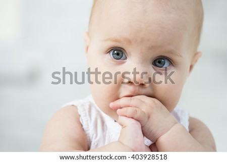 Portrait of a baby on the bed in her room - stock photo