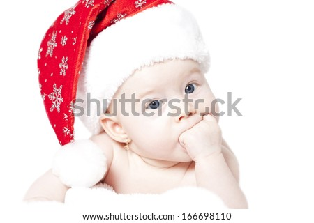 Portrait of a baby with Santa hat isolated on white - stock photo