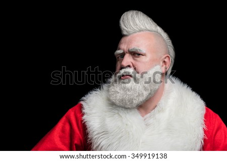 Portrait of a bad brutal mature Santa Claus with mohawk, isolated on black background - stock photo
