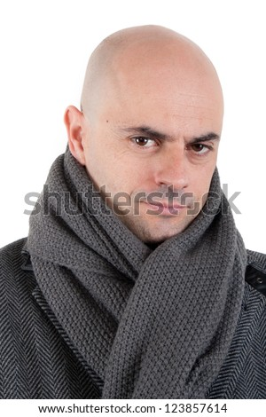 Portrait of a bald man in tweed coat and grey scarf looking at camera with half smile. Isolated. - stock photo