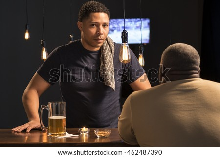 Portrait of a bartender at a bar