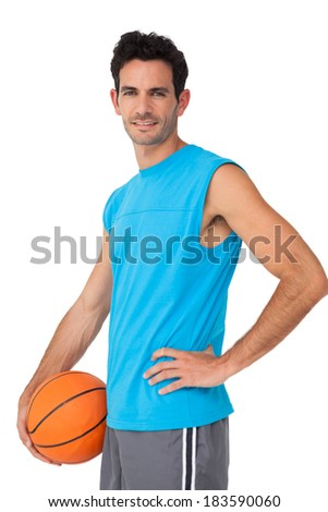 Portrait of a basketball player with ball isolated on white background