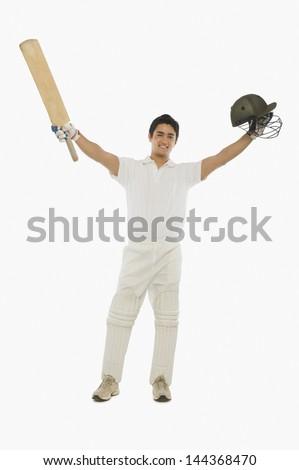Portrait of a batsman celebrating his success - stock photo