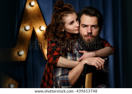 Portrait of a bearded, brutal guy and very beautiful girl - stock photo