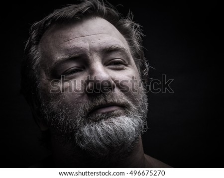 Portrait of a bearded man. Grimace. Toned.