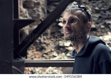 Portrait of a bearded man on a background of industrial landscape. - stock photo
