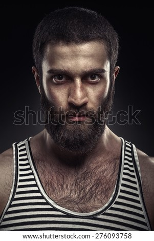 Portrait of a bearded man on dark background - stock photo