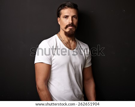 Portrait of a bearded man wearing white t-shirt - stock photo