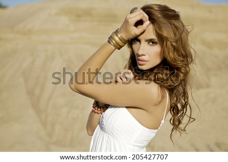portrait of a beautiful adult sensuality and attractive woman in sand background desert