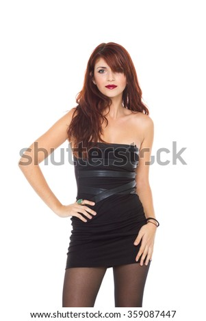 portrait of a beautiful adult sensuality woman in black dress posing over white background