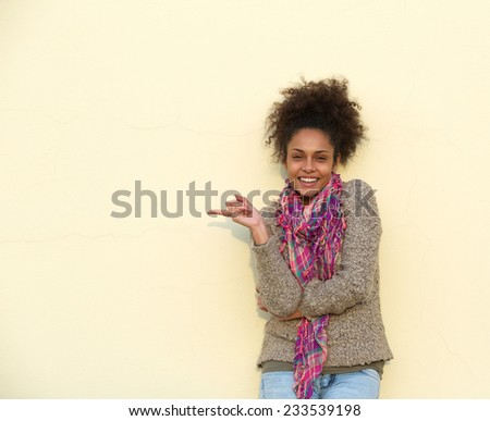 Portrait of a beautiful african american woman pointing finger - stock photo