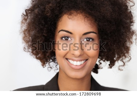 Portrait of a beautiful African American woman with a cute curly afro hairstyle and lovely wide friendly smile - stock photo