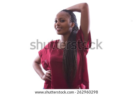 portrait of a beautiful African woman with braids in a red shirt posing on an isolated background - stock photo