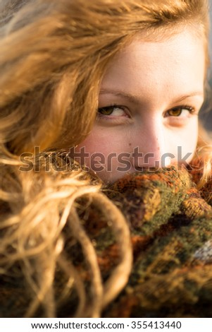 Portrait of a beautiful alternative young blonde girl with dreadlocks and a heavy scarf  - stock photo