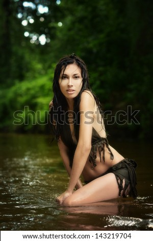portrait of a beautiful Amazon in  the river - stock photo