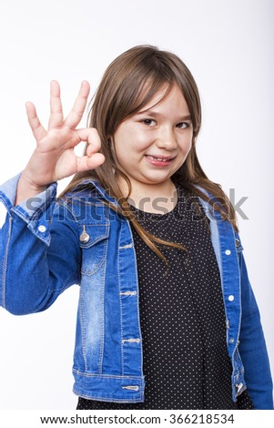 Portrait of a beautiful and confident girl showing ok sign isolated on white - stock photo
