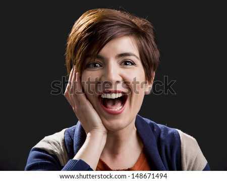 Portrait of a beautiful and happy woman laughing with a modern hair cut