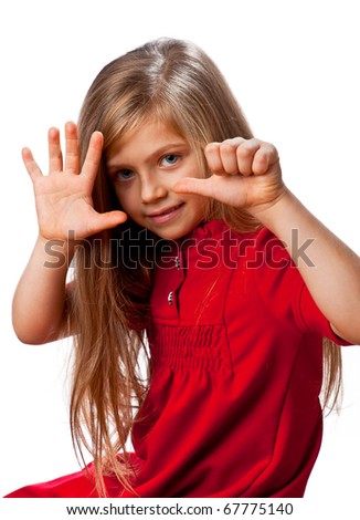 Portrait of a beautiful and little girl showing thumbs up isolated one white