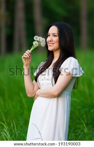 portrait of a beautiful asian  girl on nature summer