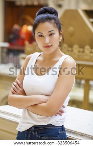 Portrait of a beautiful asian young woman in the store