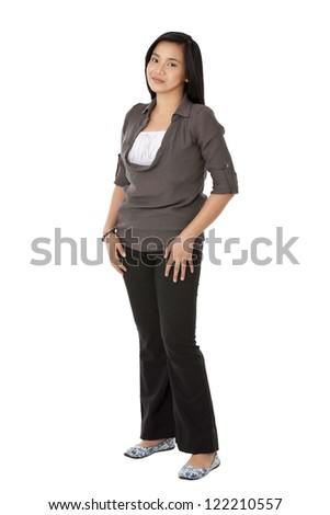 Portrait of a beautiful Asian young woman posing against plain white background