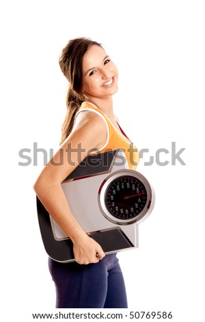Portrait of a beautiful athletic girl holding a scale, isolated on white - stock photo