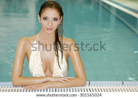 Portrait of a beautiful attractive young adult sexy and sensuality pretty brunette woman in a swimming pool.  - stock photo