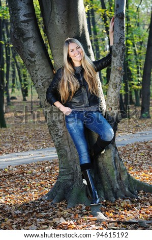 Portrait of a beautiful autumn lady in the park - stock photo