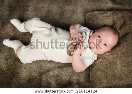 Portrait of a beautiful baby boy - stock photo